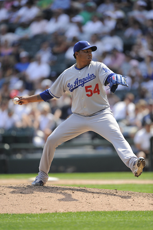 CHICAGO - JUNE 25:  Ronald Belisario #54 of the Los Angeles Dodgers pitches against the Chicago White Sox on June 25, 2009 at U.S. Cellular Field in Chicago, Illinois.  The White Sox defeated the Dodgers 6-5 in 13 innings.  (Photo by Ron Vesely)