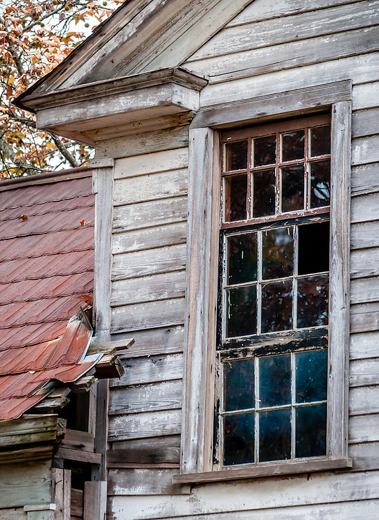 I really like the character of this window in a decaying old house near Sanford, NC, and it's contrast to the siding and roof shapes and textures. The photo was processed to emulate vintage Kodachrome color film.