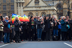 © licensed to London News Pictures. London, UK 27/03/2014. Members of the public listen to the service whilst the funeral of Tony Benn taking place at St Margaret's Church, Westminster, London. Former cabinet minister and veteran left-wing campaigner Tony Benn died at home on March 14th following a long term illness. Photo credit: Tolga Akmen/LNP