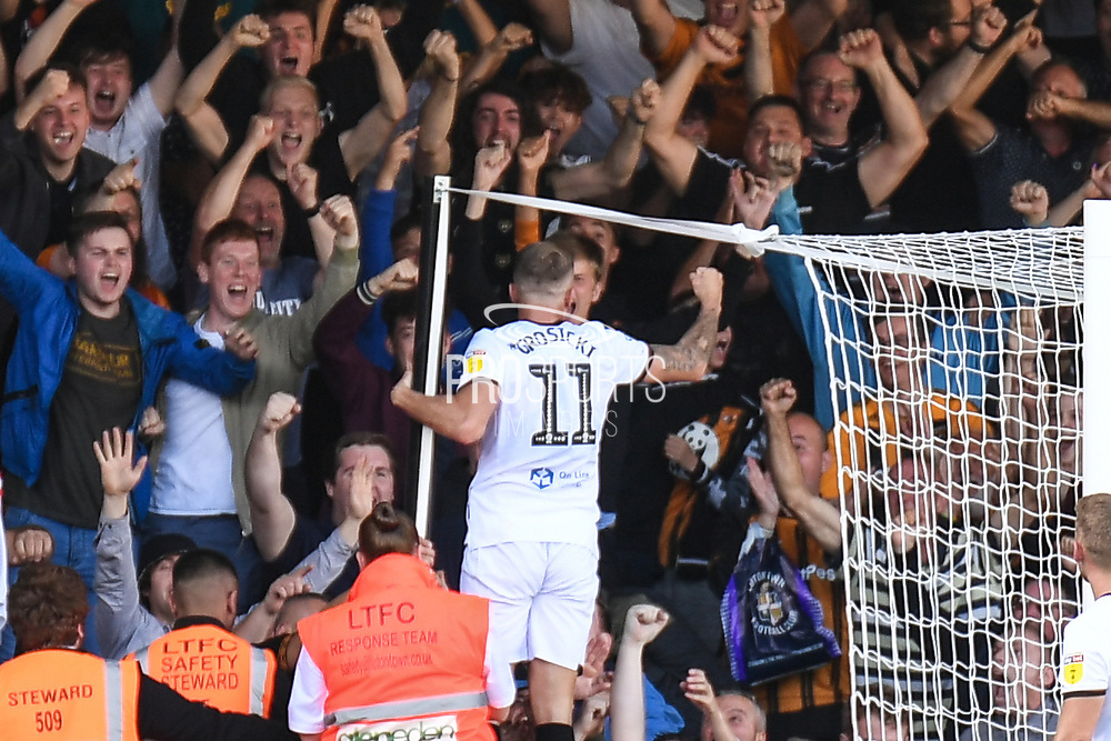 Hull City midfielder Kamil Grosicki (11) scores a goal and celebrates 0-2 with the Hull fans during the EFL Sky Bet Championship match between Luton Town and Hull City at Kenilworth Road, Luton, England on 21 September 2019.