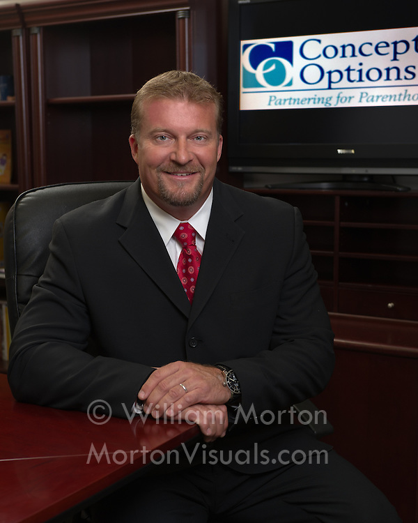 Portrait of CEO John Erickson in the board room. Executive photography by Dallas corporate photographer William Morton of Morton Visuals.