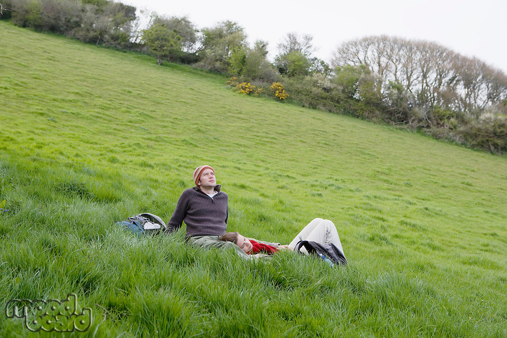 Young Couple Relaxing in the Grass
