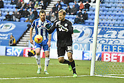 Wigan Athletic Goalkeeper, Jussi Jaskelinen comes to collect a crossduring the Sky Bet League 1 match between Wigan Athletic and Oldham Athletic at the DW Stadium, Wigan, England on 13 February 2016. Photo by Mark Pollitt.