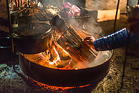 Fuel is added to the cooking fire during an annual camping trip with friends at Wharton State Forest in New Jersey on February 7, 2015.