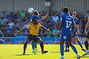 AFC Wimbledon midfielder Callum Reilly (33) beating Bristol Rovers midfielder Abu Ogogo (4) to a  during the EFL Sky Bet League 1 match between AFC Wimbledon and Bristol Rovers at the Cherry Red Records Stadium, Kingston, England on 21 September 2019.