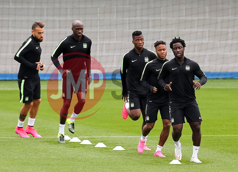 Wilfried Bony of Manchester City leads the warm up during the training session at the Etihad Stadium ahead of the UEFA Champions League group D match against Juventus - Mandatory byline: Matt McNulty/JMP - 07966386802 - 14/09/2015 - FOOTBALL - Etihad Stadium -Manchester,England - UEFA Champions League