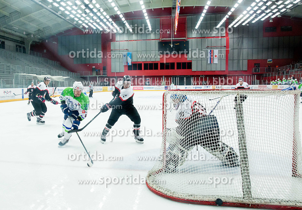 Jan Urbas of Slovenia vs Mei Ushu and Yuto Ito of Japan during ice-hockey friendly match between National teams of Slovenia and Japan, on April 10, 2015 in Arena Podmezakla, Jesenice, Slovenia. Photo by Vid Ponikvar / Sportida