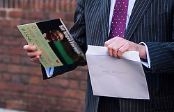 """© Licensed to London News Pictures. 28/11/2016. London, UK. Former UKIP leader NIGEL FARAGE carries a card presented to him, reading """"SIR NIGEL FARAGE - THE MAN WHO SAVED OUR COUNTRY - THANK YOU"""" following The announcement of the new leader of the UK Independence Party (UKIP), at the Emmanuel Centre in Westminster London. Former deputy leader Paul Nuttall was elected the new leader. Photo credit: Ben Cawthra/LNP"""