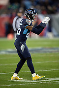 Tennessee Titans cornerback Logan Ryan (26) double high fives a teammate during the week 14 regular season NFL football game against the Jacksonville Jaguars on Thursday, Dec. 6, 2018 in Nashville, Tenn. The Titans won the game 30-9. (©Paul Anthony Spinelli)