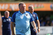 AFC Wimbledon manager Wally Downes walking off the pitch during the EFL Sky Bet League 1 match between AFC Wimbledon and Bristol Rovers at the Cherry Red Records Stadium, Kingston, England on 21 September 2019.