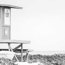 The Wedge Lifeguard Tower W and Newport Beach Jetty black and white panorama photo.  The Wedge is a popular surf spot on Balboa Peninsula in Orange County Southern California. Panoramic photo ratio is 1:3. Copyright ⓒ 2010 Paul Velgos with All Rights Reserved.