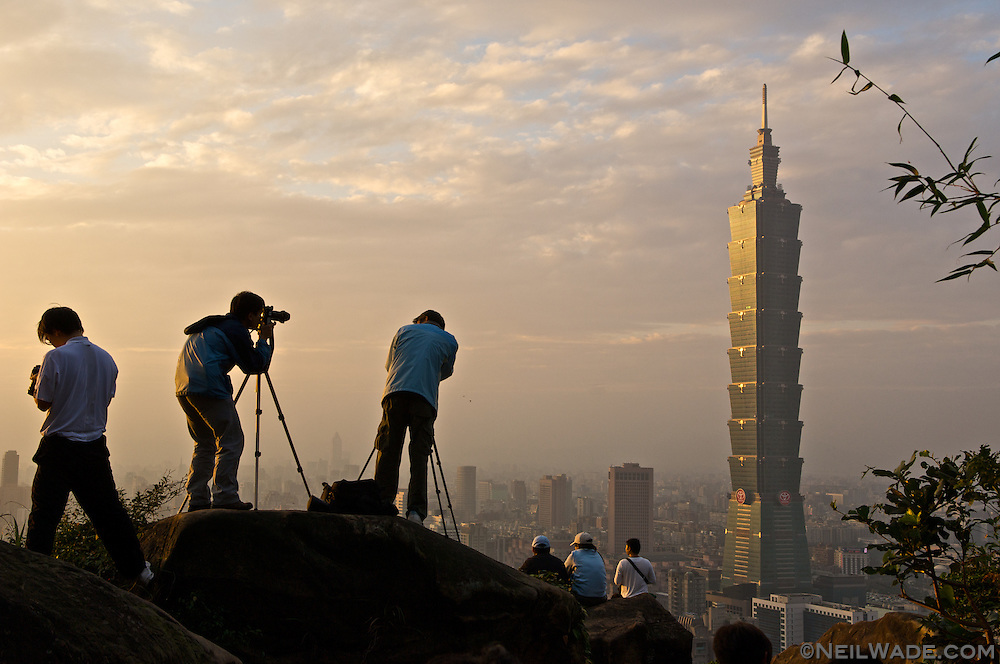 Photographers photograph Taipei 101 and the Taipei City skyline from Elephant Mountain, Taipei, Taiwan.