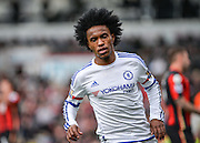 Chelsea Midfielder Willian (22) turns to celebrate after making it 1-3 during the Barclays Premier League match between Bournemouth and Chelsea at the Goldsands Stadium, Bournemouth, England on 23 April 2016. Photo by Adam Rivers.
