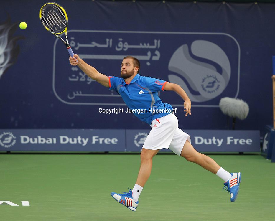 Dubai Tennis Championships 2012, ATP Tennis Turnier,International Series,Dubai Tennis Stadium, U.A.E., Mikhail Youzhny (RUS),Aktion,.Einzelbild,Ganzkoerper,Querformat,