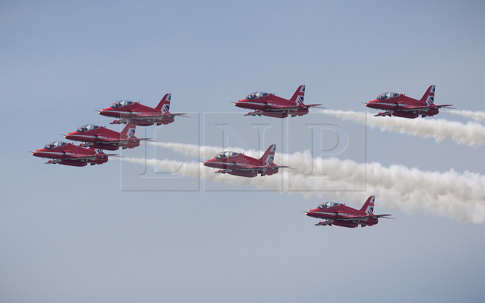 © Licensed to London News Pictures. 22/07/2016. Portsmouth, United Kingdom. The Royal Air Force Aerobatics Display Team, The Red Arrows, performing before the practice day for the America's Cup World Series (ACWS) in Portsmouth this weekend, 22nd-24th July 2016. British Olympic sailing legend, Sir Ben Ainslie, is leading his all-British team, Land Rover BAR, against other teams in a battle to qualify for a place in the two team America's Cup final, to be held in Bermuda in 2017. Today (22/07/16) is a practice day, followed by two days of racing. Photo credit: Rob Arnold/LNP