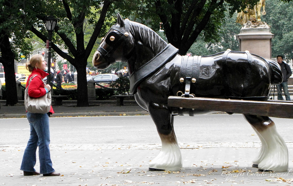 """""""Perceval"""", a life-sized horse and cart by artist Sarah Lucas at The Doris Fereedman Plaza in Central Park."""