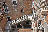The inner courtyard of a Venice palazzo, looking down from above.