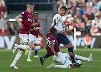 Football - 2018 / 2019 Premier League - West Ham United vs. Tottenham Hotspur<br /> <br /> Issa Diop (West Ham United) stretches to reach Erik Lamela (Tottenham FC)  before he breaks away at the London Stadium<br /> <br /> COLORSPORT/DANIEL BEARHAM