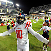 Mississippi defensive end C.J. Johnson (10) celebrates after an NCAA college football game against Texas A&M in College Station, Texas, Saturday, Oct. 11, 2014. No. 3 Mississippi won 35-20. (Photo/Thomas Graning)