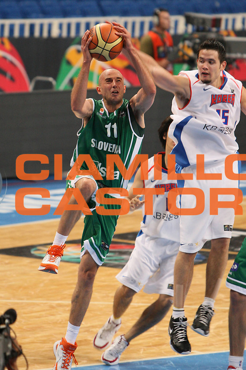 DESCRIZIONE : Atene Athens 2008 Fiba Olympic Qualifying Tournament For Men Korea Slovenia<br />GIOCATORE : Nebojsa Joksimovic<br />SQUADRA : Slovenia<br />EVENTO : 2008 Fiba Olympic Qualifying Tournament For Men <br />GARA : Korea Slovenia<br />DATA : 14/07/2008 <br />CATEGORIA : Tiro<br />SPORT : Pallacanestro <br />AUTORE : Agenzia Ciamillo-Castoria/G.Ciamillo<br />Galleria : 2008 Fiba Olympic Qualifying Tournament For Men<br />Fotonotizia : Atene Athens 2008 Fiba Olympic Qualifying Tournament For Men Korea Slovenia<br />Predefinita :