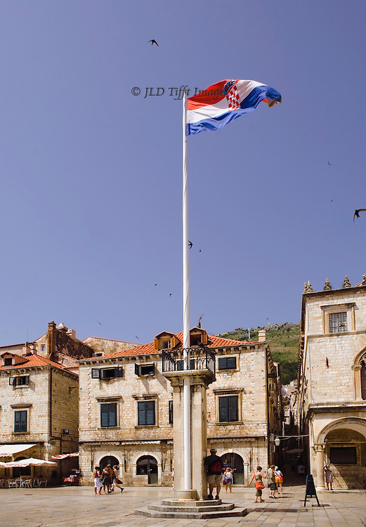 Dubrovnik restored: Croatian flag flying in the old town square .