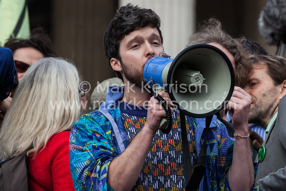 London, UK. 16 October, 2019. Matthew Shribman, science presenter and campaigner, addresses hundreds of climate activists from Extinction Rebellion defying the Metropolitan Police prohibition on Extinction Rebellion Autumn Uprising protests throughout London under Section 14 of the Public Order Act 1986 by attending a Right to Protest assembly in Trafalgar Square.