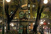 WA15275-00...WASHINGTON - Evening at Pioneer Square with view of the Tlingit Indian Totem and the Iron Pergola.