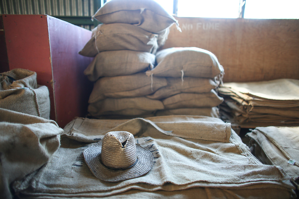 A worker's hat rests near sacks of coffee inside the mill at Bella Vista coffee farm during the 2016 Starbucks Origin Experience for Partners. Photographed on Monday, January 11, 2016. (Joshua Trujillo, Starbucks)