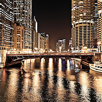 Chicago skyline at State Street Bridge (Bataan-Corregidor Memorial Bridge) at night along the Chicago River with the Leo Burnett Building (35 West Wacker Drive), 55 West Wacker, United Airlines Building (77 West Wacker Drive), LaSalle-Wacker Building (221 North La Salle Street), and Marina City Towers.