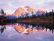 sunset on Mt Shuksan reflecting in Picture Lake, North Cascades National Park, Washington State