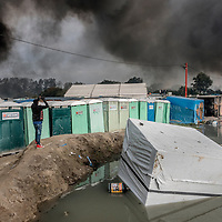 26th October 2016, The Jungle of Calais in France is in huge fire. A migrant taking picture of the fire.