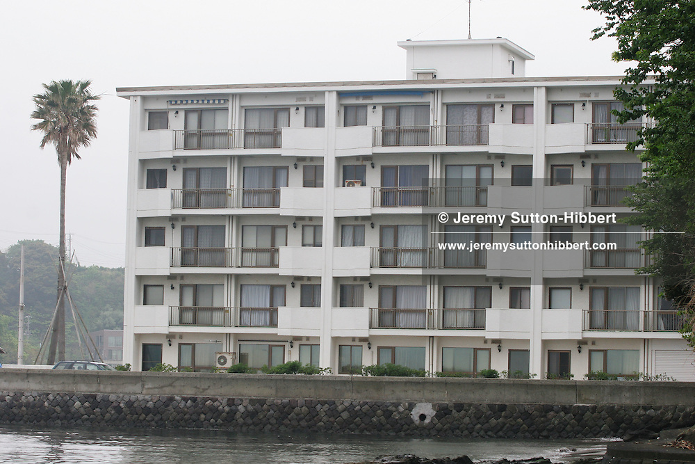 The apartment block where Joji Obara had an apartment, close to the cave on Aburatsubo beach where the body of UK national Lucy Blackman was found buried in a cave in Feb.2001. Aburatsubo beach, near Tokyo, Japan on Monday, April 23rd 2007.  The verdict will be announced in the trial of Joji Obara for Lucy Blackman's murder (and rapes of other women) on Tuesday April 24th 2007,