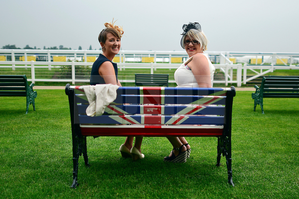 © London News Pictures. 20/06/2013. Ascot, UK. Ladies Day on day three of Royal Ascot at Ascot racecourse in Berkshire, on June 20, 2013. The 5 day showcase event, which is one of the highlights of the racing calendar, has been held at the famous Berkshire course since 1711 and tradition is a hallmark of the meeting. Top hats and tails remain compulsory in parts of the course.  Photo credit : Stephen Simpson/LNP