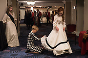 HELEN STEWART HAVING EMERGENCY DRESS REPAIR FROM EMILY ROSE WETHERELL, CASSANDRA KRIENER-MILBRANDT WATCHING,  BY  The Royal Caledonian Ball 2017, Grosvenor House, 29 April 2017