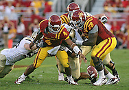 September 26, 2009: Iowa State quarterback Austen Arnaud (4) fumbles the ball during the first half of the Iowa State Cyclones' 31-10 win over the Army Black Knights at Jack Trice Stadium in Ames, Iowa on September 26, 2009. Arnaud recovered the ball on the play.
