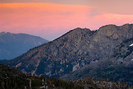 Alpenglow on clouds at sunset over Angora Peak and Indian Rock, from Desolation Wilderness, El Dorado National Forest, California