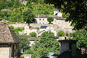 Sainte-Enimie is a commune in the Lozère department in southern France. It was founded in the seventh century by Énimie, who started a convent there after being cured of leprosy in the surrounding waters. It was the site of several monasteries, some of which still remain. Located in the Gorges du Tarn, it is one of les Plus Beaux Villages de France.