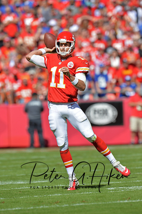 KANSAS CITY, MO - SEPTEMBER 29:  Quarterback Alex Smith #11 of the Kansas City Chiefs passes the ball down field against the New York Giants during the first half on September 29, 2013 at Arrowhead Stadium in Kansas City, Missouri.  (Photo by Peter G. Aiken/Getty Images) *** Local Caption *** Alex Smith