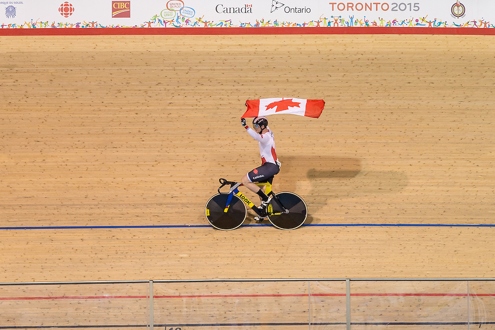 Evan Carey of Canada celebrates his team's gold medal win over Venezuela in the men's team sprint at the 2015 Pan American Games in Toronto, Canada, July 16,  2015.  AFP PHOTO/GEOFF ROBINS