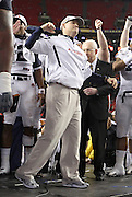 ATLANTA - DECEMBER 4:  Head coach Gene Chizik of the Auburn Tigers celebrates on the podium after the 2010 SEC Championship against the South Carolina Gamecocks at Georgia Dome on December 4, 2010 in Atlanta, Georgia. The Tigers beat the Gamecocks 56-17.  (Photo by Mike Zarrilli/Getty Images)