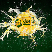 Carlsberg filled sphere exploding on a green background Ray Massey is an established, award winning, UK professional  photographer, shooting creative advertising and editorial images from his stunning studio in a converted church in Camden Town, London NW1. Ray Massey specialises in drinks and liquids, still life and hands, product, gymnastics, special effects (sfx) and location photography. He is particularly known for dynamic high speed action shots of pours, bubbles, splashes and explosions in beers, champagnes, sodas, cocktails and beverages of all descriptions, as well as perfumes, paint, ink, water – even ice! Ray Massey works throughout the world with advertising agencies, designers, design groups, PR companies and directly with clients. He regularly manages the entire creative process, including post-production composition, manipulation and retouching, working with his team of retouchers to produce final images ready for publication.