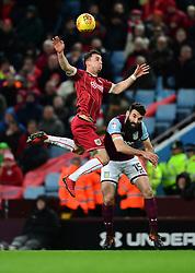 Joe Bryan of Bristol City battles for the high ball with  Robert Snodgrass of Aston Villa  - Mandatory by-line: Joe Meredith/JMP - 01/01/2018 - FOOTBALL - Villa Park - Birmingham, England - Aston Villa v Bristol City - Sky Bet Championship