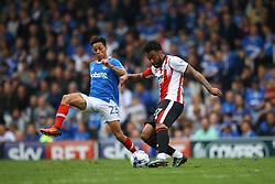 Kyle Bennett of Portsmouth attempts to block Jordan Cranston of Cheltenham Town - Mandatory by-line: Jason Brown/JMP - 06/05/2017 - FOOTBALL - Fratton Park - Portsmouth, England - Portsmouth v Cheltenham Town - Sky Bet League Two