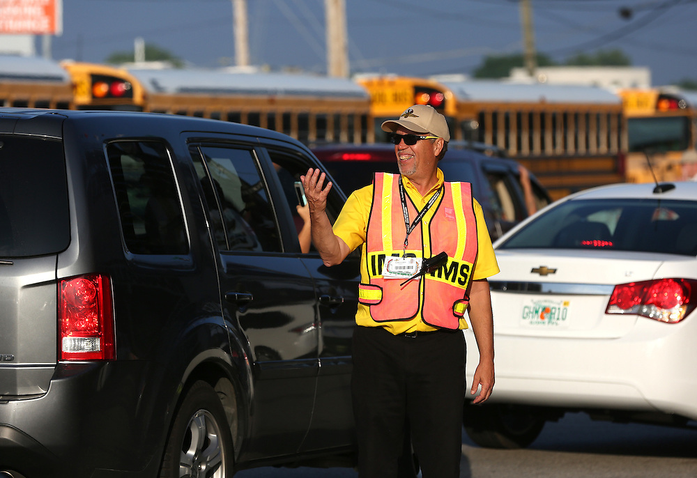 An official directs traffic during the 100th running of the Indianapolis 500 May 29, 2016.