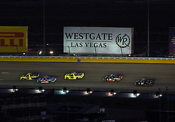 September 14, 2018 - Las Vegas, NV, U.S. - LAS VEGAS, NV - SEPTEMBER 14: Grant Enfinger (98) Champion Power Equipment, Curb Records Curb Racing Ford F-150 leads the field through turn two during the NASCAR Camping World Truck Series Playoff Race World of Westgate 200 on September 14, 2018, at the Las Vegas Motor Speedway in Las Vegas, NV. (Photo by Chris Williams/Icon Sportswire) (Credit Image: © Chris Williams/Icon SMI via ZUMA Press)