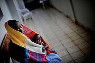Outreach Centre Fistula Hospital, Yirgalem, Ethiopia - this woman is resting on a bank on the outdoor corridor of the hospital, recovering from her operation. Most women lose their children during long, obstructed labour. The hospital cares for whole families if they come to ask for help after experiencing incontinence that occurs if the long labour leads to holes in the vagina due to loss of blood circulation when the head of the baby presses into the perineum. If the women get pregnant again, the doctors here arrange for C-Sections to be performed during the next pregnancies.