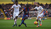 Yannick Bolasie makes a break through Daley Blind and Anthony Martial during the Barclays Premier League match between Crystal Palace and Manchester United at Selhurst Park, London, England on 31 October 2015. Photo by Michael Hulf.