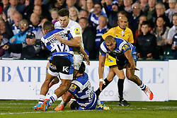 Saracens Outside Centre Duncan Taylor is tackled by Bath Inside Centre Kyle Eastmond and Full Back Gavin Henson - Photo mandatory by-line: Rogan Thomson/JMP - 07966 386802 - 03/10/2014 - SPORT - RUGBY UNION - Bath, England - The Recreation Ground - Bath Rugby v Saracens - Aviva Premiership.