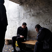 DONETSK, UKRAINE - OCTOBER 16, 2014: IDPs at a bomb shelter in Petrovskiy district of Donetsk socialize outside the shelter during a pause in the fighting between DNR separatist combatants and the Ukrainian National Guard for the control of Donetsk city. More than one hundred people have been living for the past four months at the shelter. CREDIT: Paulo Nunes dos Santos