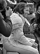 Two-time Formula One World Champion Emerson Fittipaldi spent his final day as a Formula One driver denying rumors of his retirement. Here he takes a moment to sit in the warmth of the sun to answer reporters questions before the start of the 1980 United States Grand Prix at Watkins Glen, NY.<br />